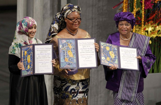 Nobel Peace Prize winners pose with their awards during a ceremony in Oslo