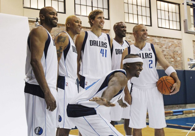 Dallas players Carter, Marion, Nowitzki, Odom, Kidd, and Terry pose for photos during media day at the team's headquarters in Dallas, Texas