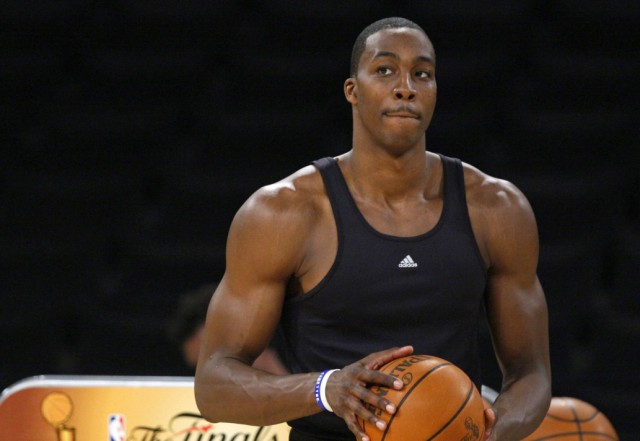 Orlando Magic center Dwight Howard wears two cell phones on his hip as he prepares to practice for Game 2 of their NBA Finals basketball series in Los Angeles