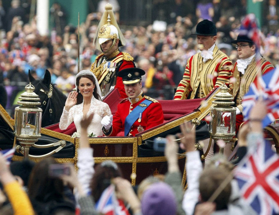 Britain's Prince William and his wife Catherine, Duchess of Cambridge, travel to Buckingham Palace along the Procession Route after their wedding in Westminster Abbey, in central London
