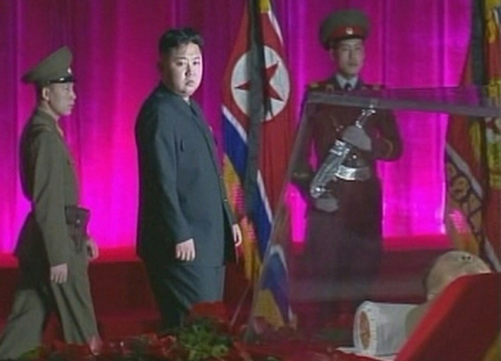 New North Korean ruler Kim Jong-un pays his respects to his father and former leader Kim Jong-il who is lying in state at the Kumsusan Memorial Palace in Pyongyang