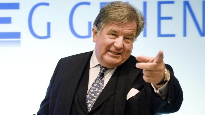 Juergen Grossmann gestures to the media in Essen