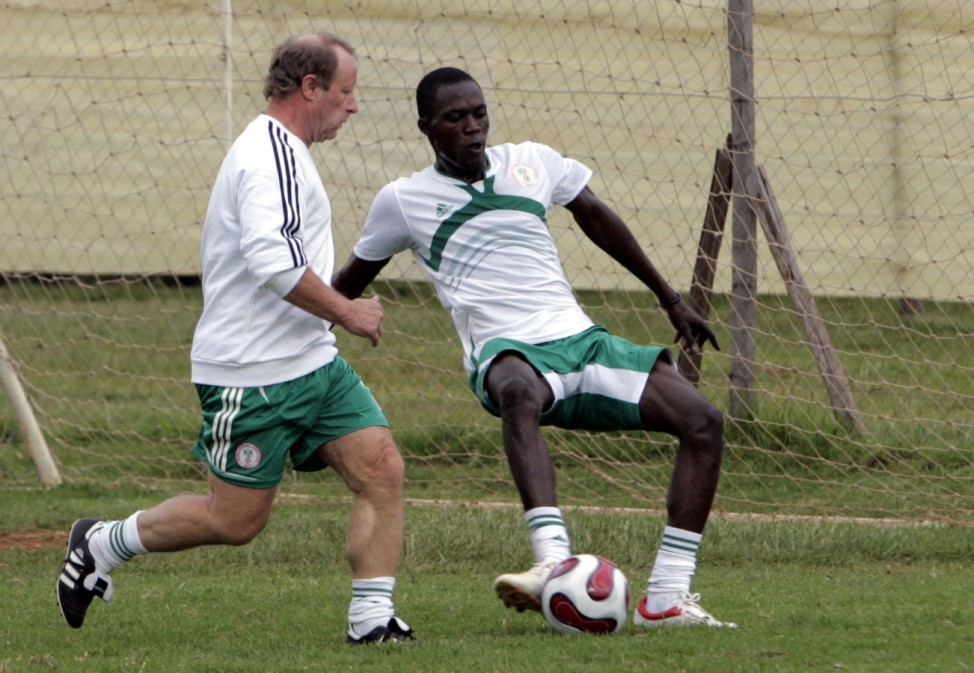 Nigeria's soccer coach Berti Vogts from Germany is challenged by Ifeanyi Onwuatu during a training session at the Hope centre in the outskirts of capital Nairobi