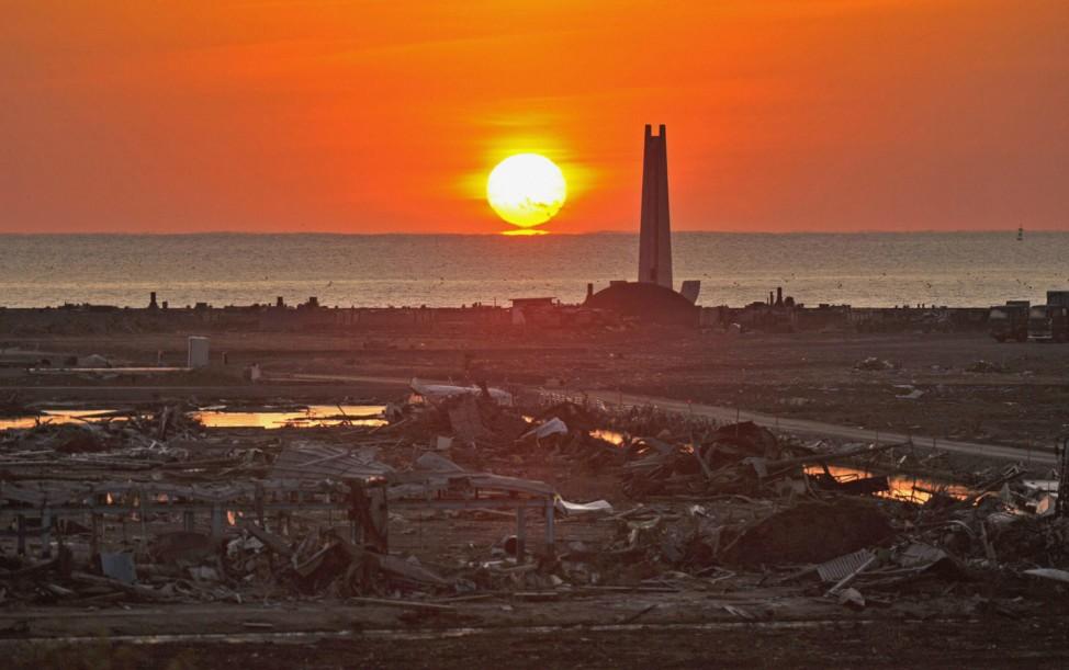 The New Year sunrise lights up an area devastated by March 2011 tsunami in Kesennuma
