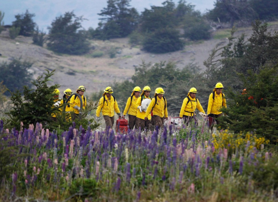 Firefighters prepare to tackle a wildfire at the Chilean Torres del Paine national park in the southern Patagonia region of Chile