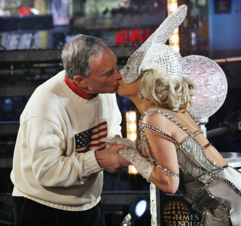 Singer Lady Gaga and New York City Mayor Michael Bloomberg kiss each other during celebrations at the New Year Eve ball in Times Square in New York