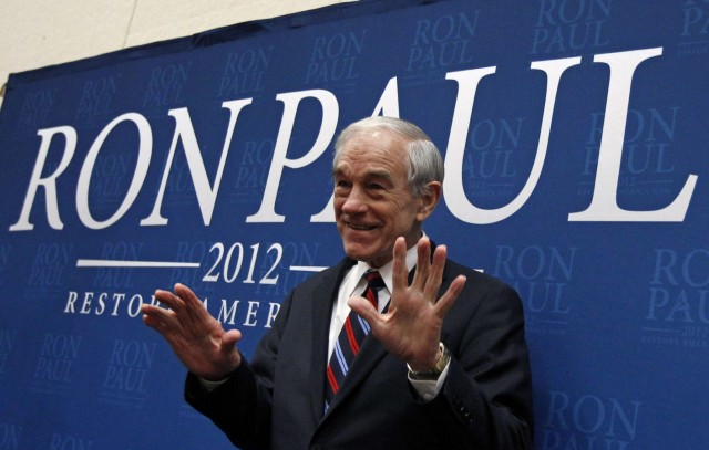 U.S. Republican presidential candidate and Congressman Ron Paul acknowledges the applause of the crowd as he arrives for a campaign stop in Cedar Falls, Iowa