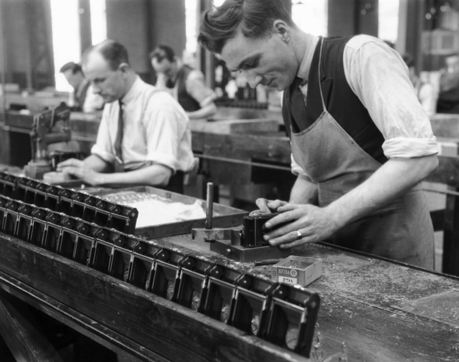 Production line worker assembling a Kodak c
