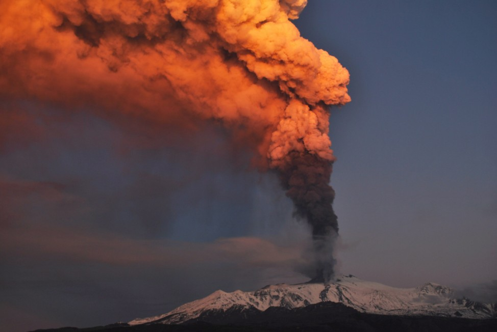 A cloud of hot ash erupts from the summit of Etna volcano