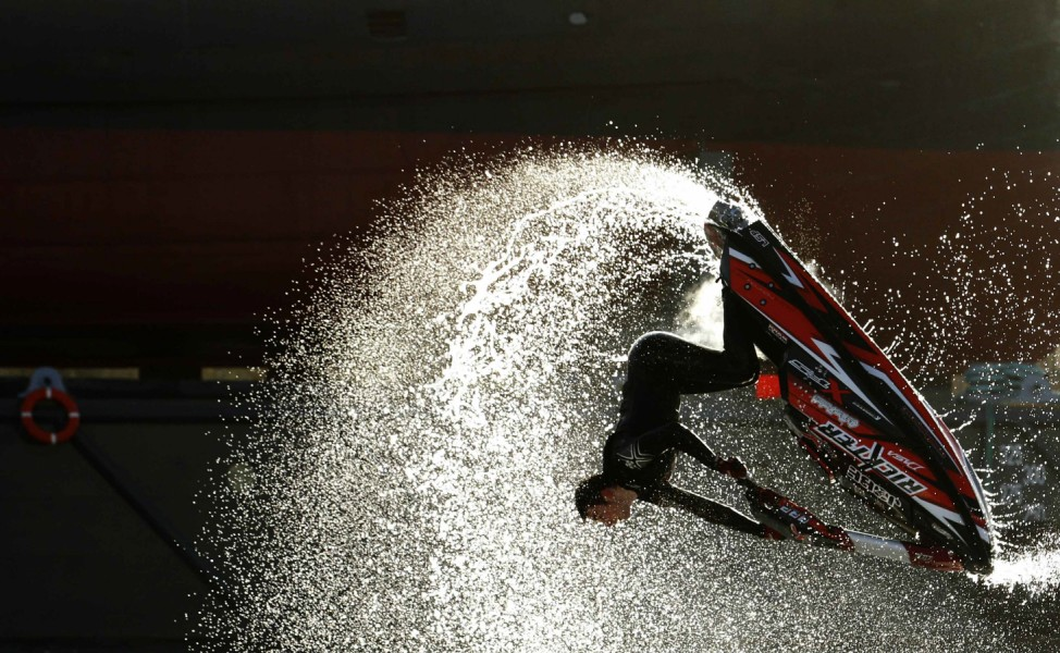 Freestyle jet-ski champion Jack Moule performs at the London Boat Show at the ExCeL centre in London