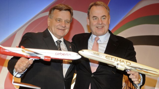 File photo of Hartmut Mehdorn and James Hogan posing for the media during a news conference in Berlin