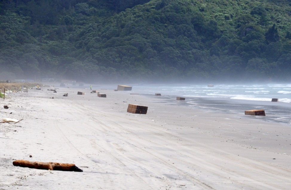Containers from the stricken cargo ship Rena that washed up on Wa