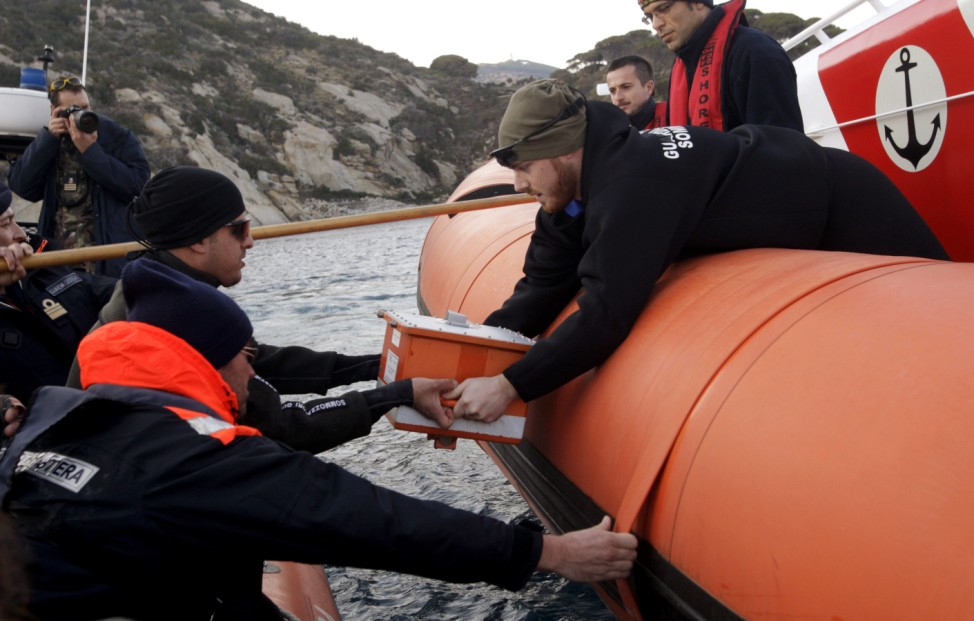 Italian Coast Guard personnel recover the black box from the Costa Concordia cruise ship that ran aground at Giglio island