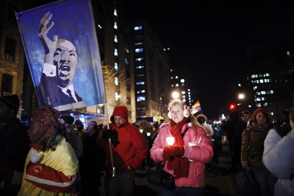Occupy Wall Street members march during a candlelight vigil to honor Rev. Martin Luther King, Jr. in New York