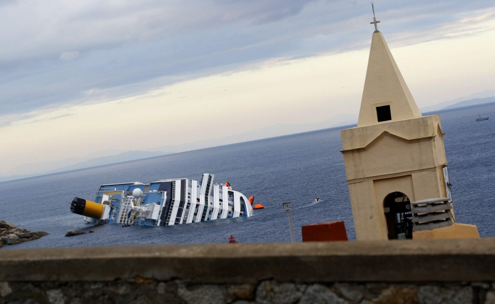 A view shows the capsized Costa Concordia cruise ship lying on its side at Giglio island