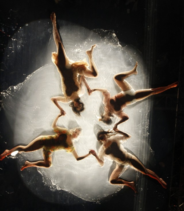 Dancers perform on watery stage during Fuerza Bruta dress rehearsal in Berlin