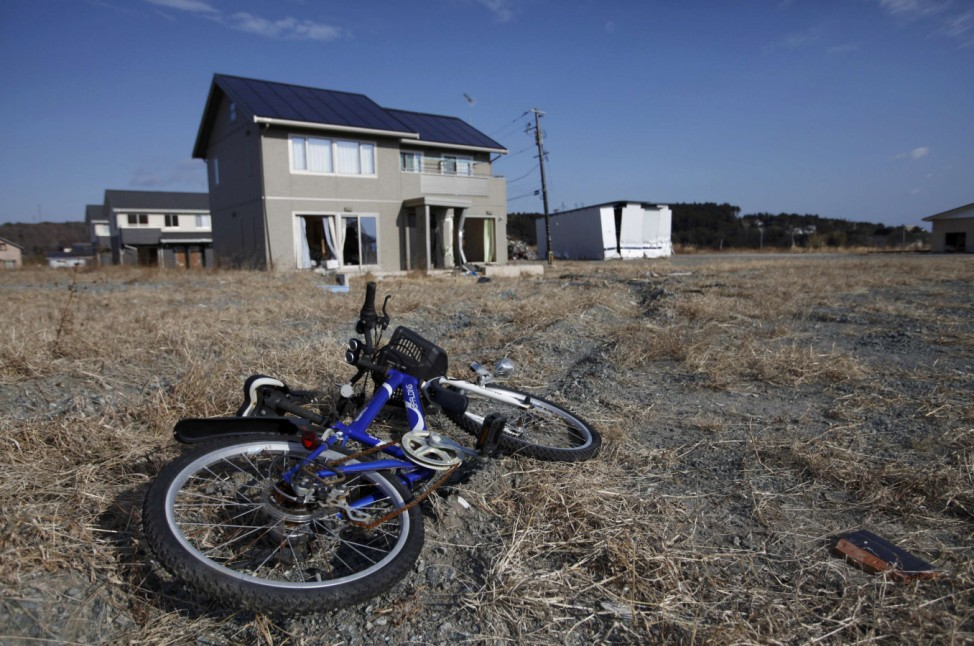 An abandoned child's bicycle is seen in Tomioka town in the Fukushima exclusion zone