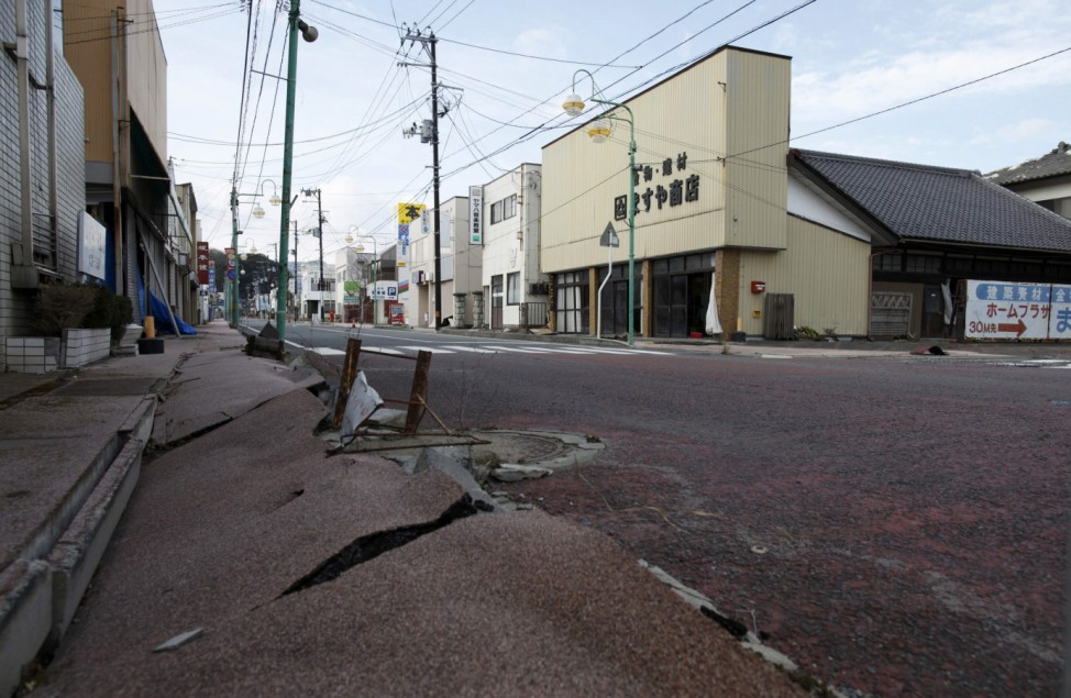Road cracks caused by an earthquake are seen in an empty shopping street in Tomioka town in the Fukushima exclusion zone