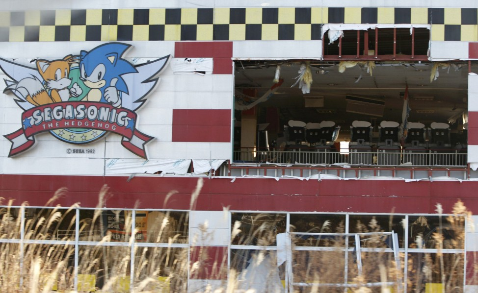 A games arcade destroyed by the 2011 earthquake is seen along Route 6 in Tomioka town inside the Fukushima exclusion zone