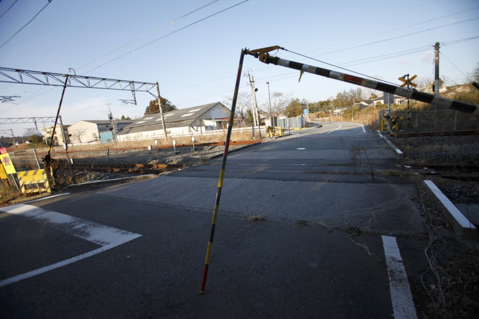 A destroyed crossing bar on the Joban line railway is seen near Futaba station inside the Fukushima exclusion zone