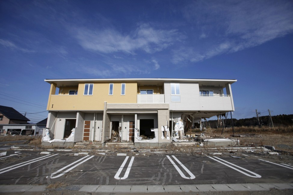 Houses destroyed by the 2011 tsunami are seen in Tomioka town inside the Fukushima exclusion zone