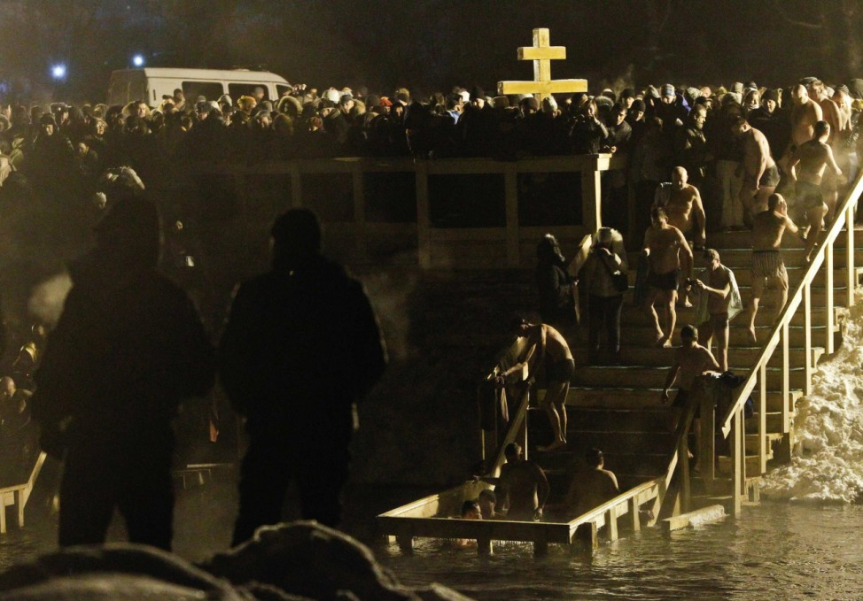 People queue to take a dip in the icy waters of the Istra river during Orthodox Epiphany celebrations in Russia's town of New Jerusalem in Moscow Region