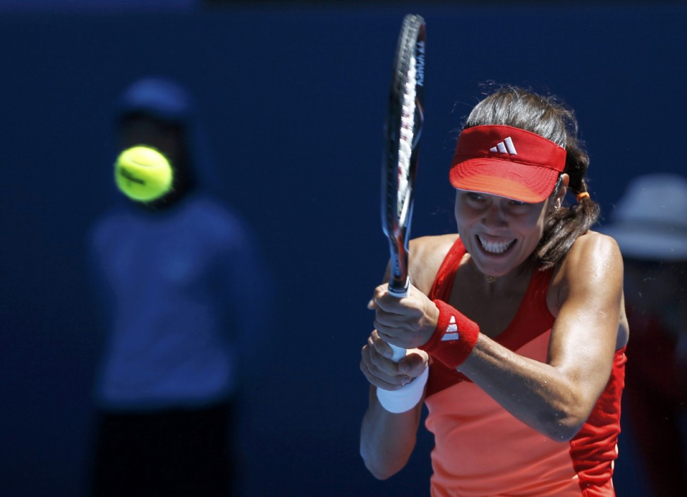 Ivanovic of Serbia hits a return to Krajicek of the Netherlands during their match at the Australian Open in Melbourne