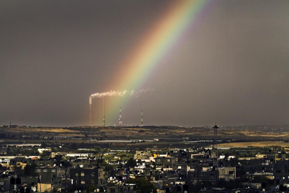 A rainbow rises over northern Gaza Strip