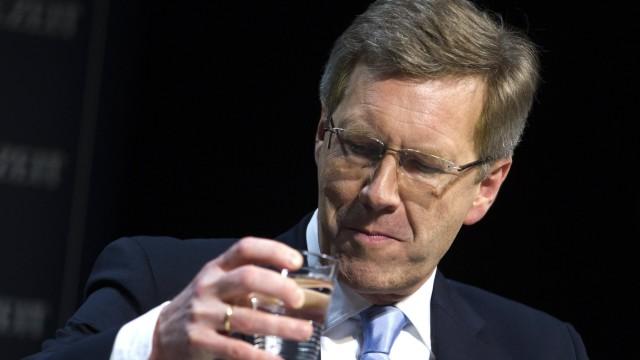 German President Wulff drinks water before public talk at the Berliner Ensemble theatre in Berlin