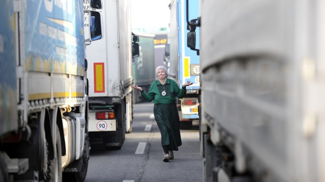 Monica a German trucker gestures on Turin highway during a truckers' protest against the government's deregulation plans in Turin