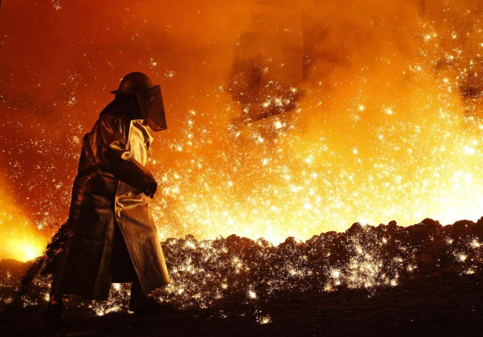 Worker controls the cast at a blast furnace of German steel manufacturer Salzgitter AG in Salzgitter