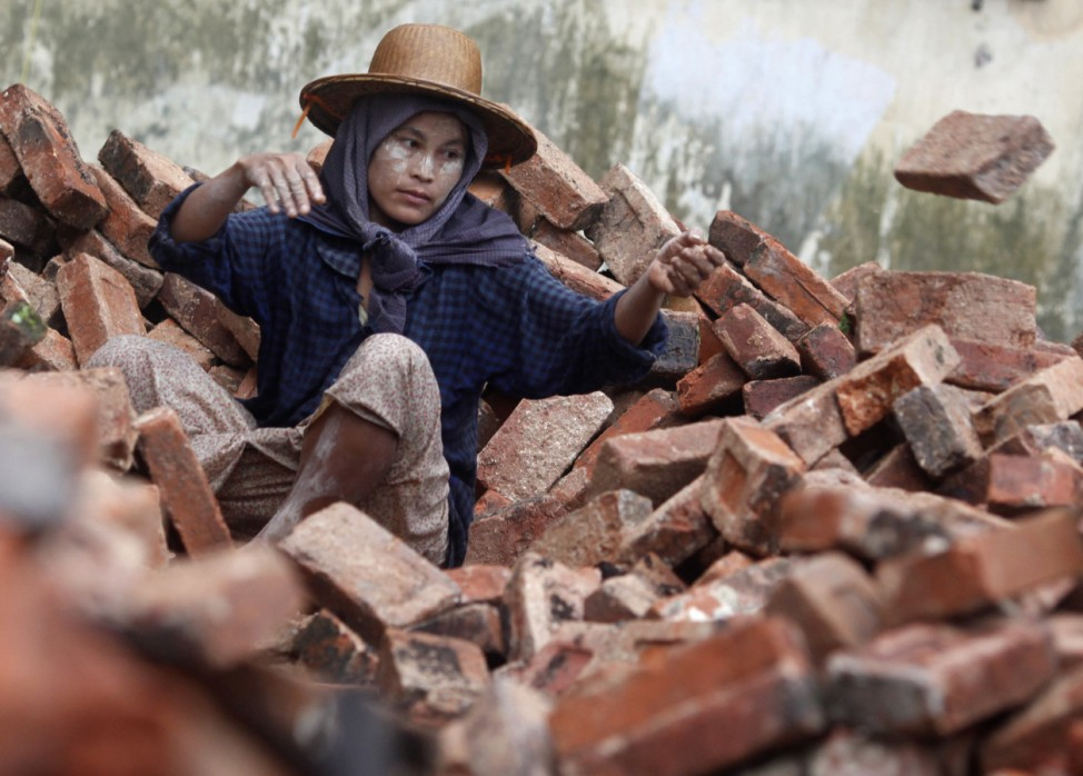 A woman works at a construction site in Yangon