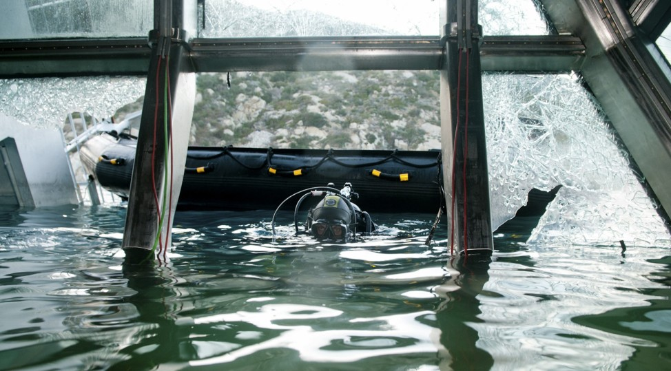 A scuba diver of Italian Navy inspects the Costa Concordia cruise ship which ran aground off the west coast of Italy at Giglio island
