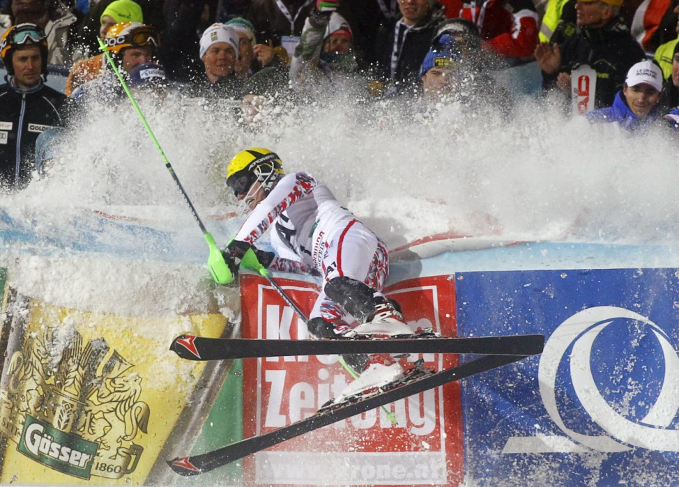 Marcel Hirscher of Austria crashes into the barrier after winning the Alpine Skiing World Cup Slalom race in Schladming