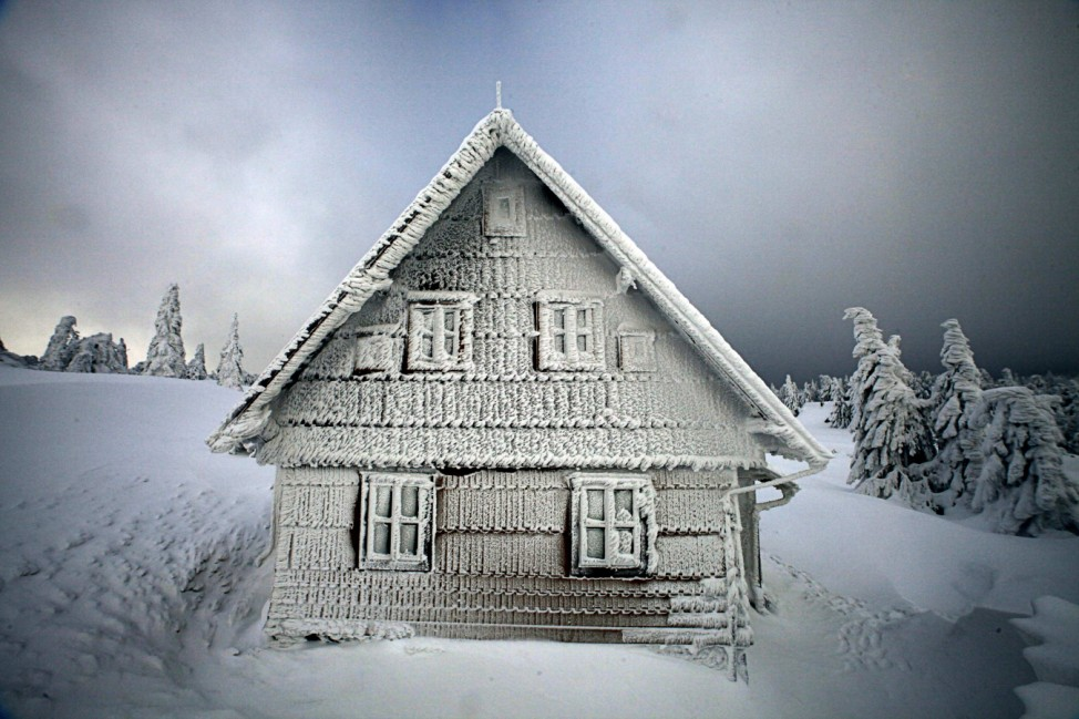 A frozen house is seen on a track of the Sedivackuv Long dog sled race in Destne v Orlickych horach