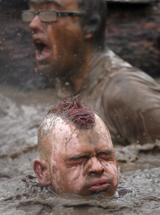 A competitor exits the water during the Tough Guy event in Perton