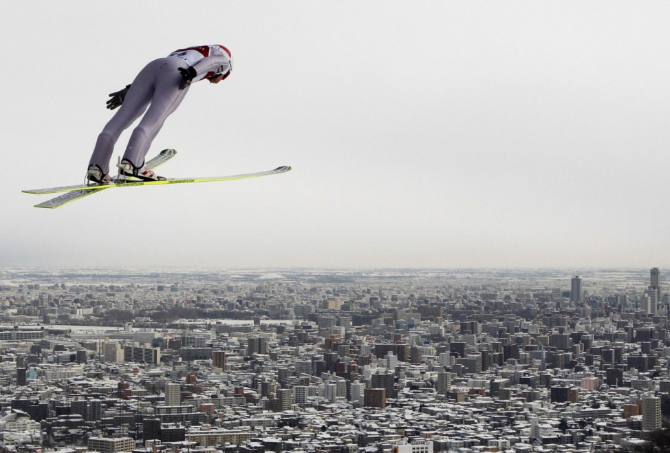 Poland's Stoch soars through the air during a trial round in the FIS World Cup Ski Jumping in Sapporo