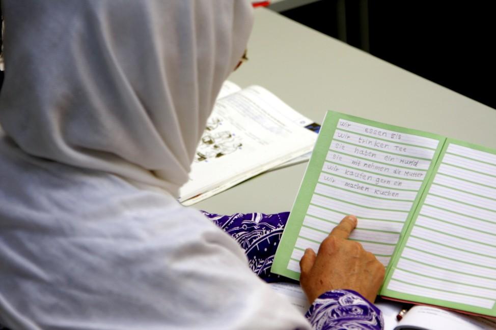 Migrantin beim Sprachkurs, 2010
