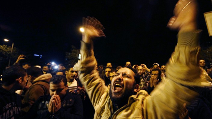 A man reacts at Ramsis metro station in Cairo after the arrival of people wounded in clashes in Port Said stadium