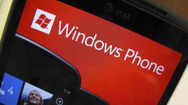 An AT&T phone running the Windows Phone operating system is shown for sale at a Microsoft retail store in San Diego