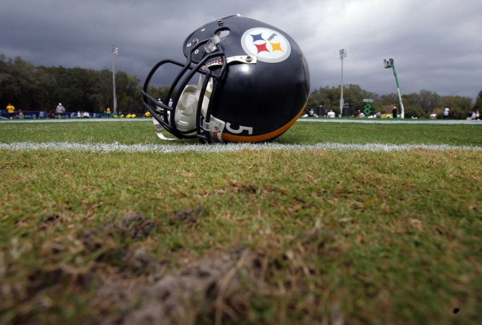 The helmet of a Pittsburgh Steelers player sits on the ground during practice at the University of South Florida in Tampa