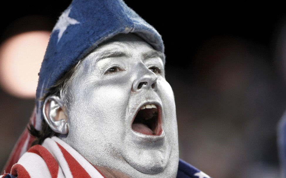A Patriots fan shouts during the Denver Broncos and New England Patriots NFL AFC Divisional playoff game in Foxborough