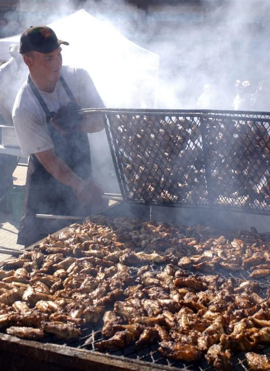 Chapman flips chicken wings for National Chicken Wing Festival in Buffalo, New York
