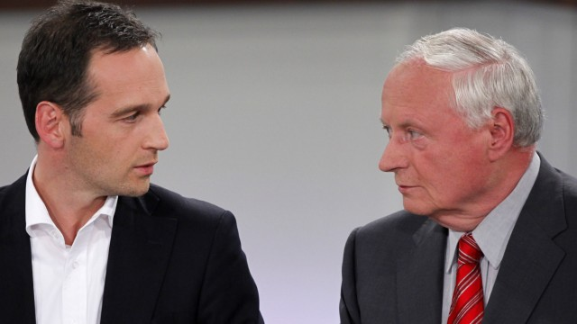 Lafontaine, top candidate of the Left wing party 'Die Linke' and Maas, Social Democratic Party (SPD) top candidate react during  a TV interview in Saarbruecken