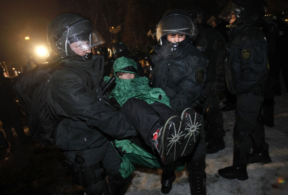 German police remove a demonstrator from a park in Stuttgart