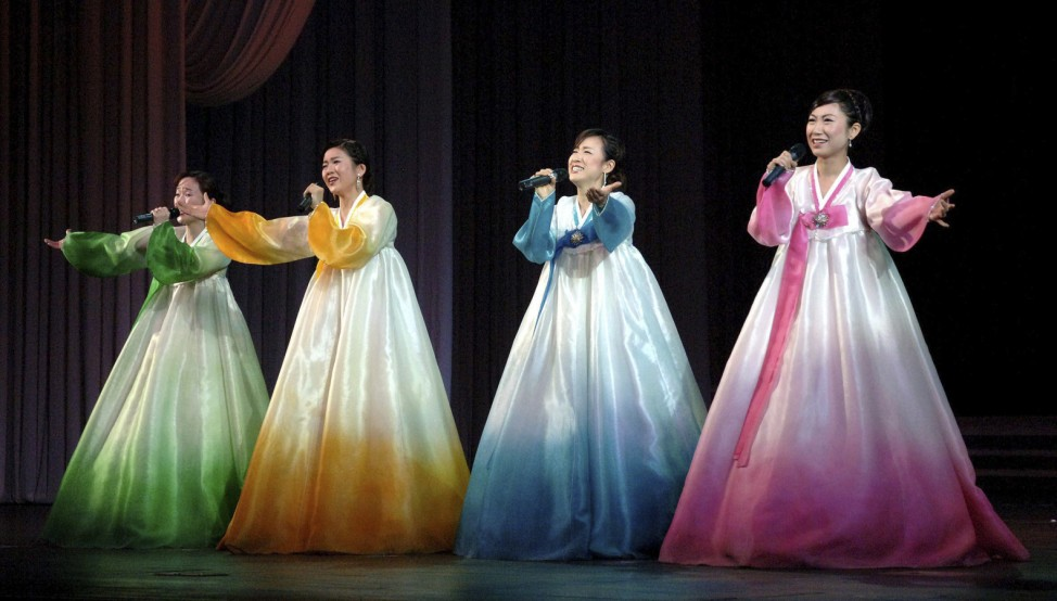Members of art troupe of Korean people living in Japan perform on the occasion of birth anniversary of late North Korean leader Kim Jong-il in Pyongyang in this picture released by North Korea's KCNA news agency