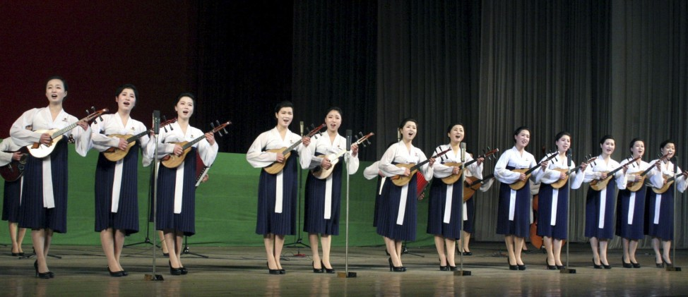 Members of an art group of university students perform at the Central Youth Hall in Pyongyang to mark 'the Day of the Shining Star', the birth anniversary of late North Korean leader Kim Jong-il