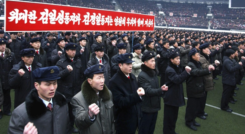 North Koreans chant slogans during a rally to pledge their loyalty to leader Kim Jong-Un at the Kim Il Sung Stadium in Pyongyang