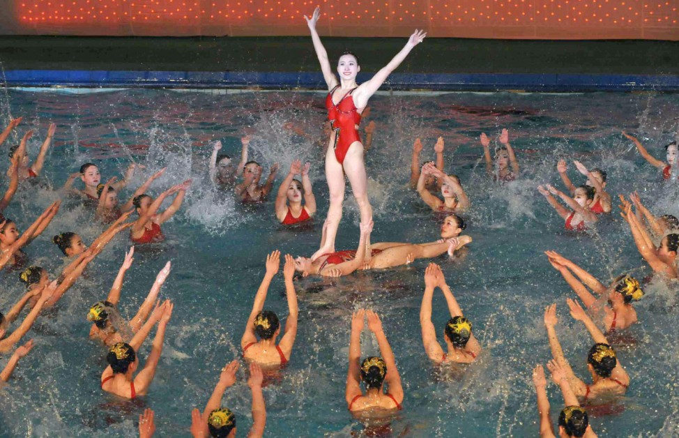 North Koreans perform synchronized swimming program during a festival to mark the birth anniversary of the North's late leader Kim Jong-Il in Pyongyang