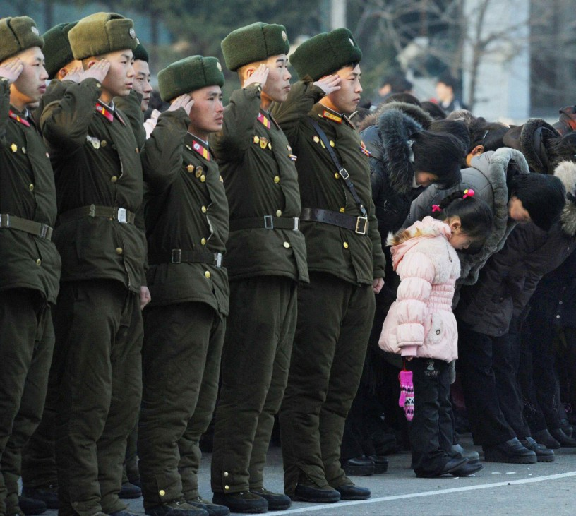 North Korean soldiers and residents send a salute to mark the birth anniversary of the North's late leader Kim Jong-Il in Pyongyang